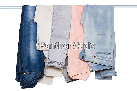 hanging jeans isolated closeup of collection