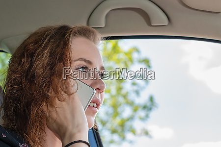young woman drives her car and