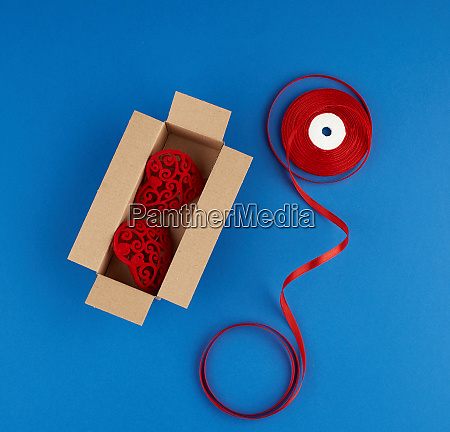 rectangular brown cardboard box and red