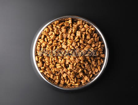 dry pet food in a metal