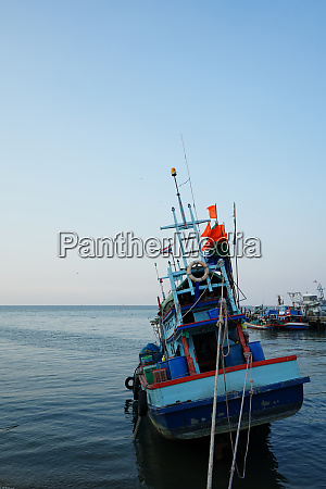 a fishing boat held by ropes