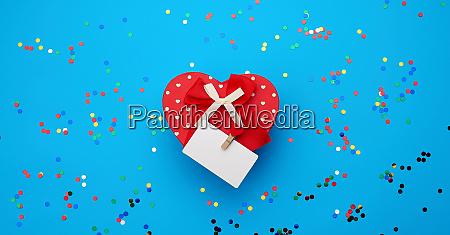 closed red heart shaped cardboard box