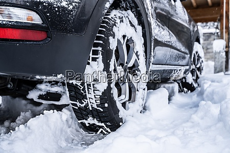 car tire with snow after snowfall