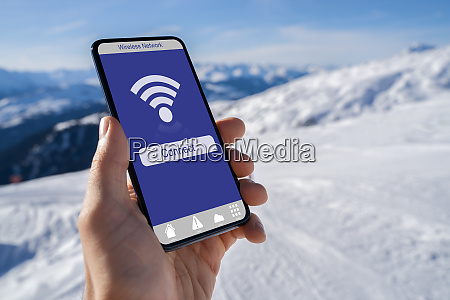 hand holding mobile phone with wireless