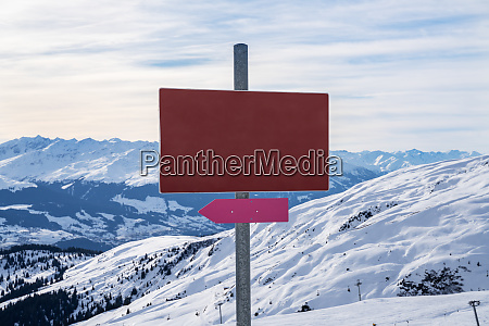 empty red sign in mountains