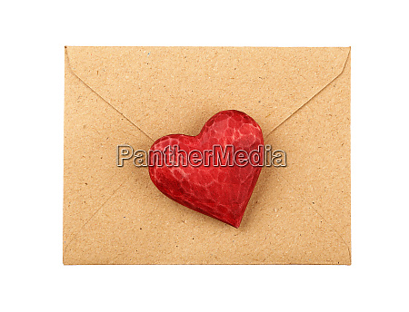 red wooden heart on envelope isolated