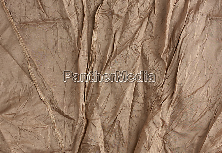 texture of crumpled brown synthetic fabric