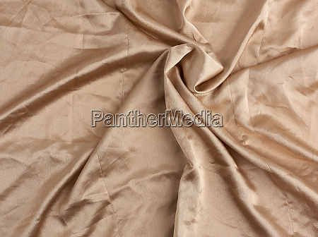 beige satin textile fabric piece of
