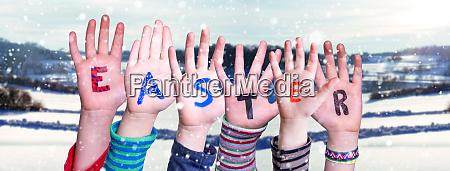 children hands building word easter winter