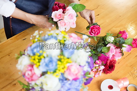 female florist at work using arranging