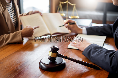 lawyer in office counseling and giving