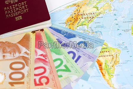 canadian dollars with passport on the