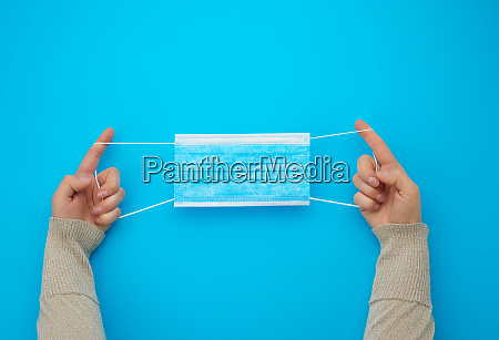 female hands protracted blue sterile textile