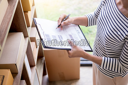 businessman shop owner check order
