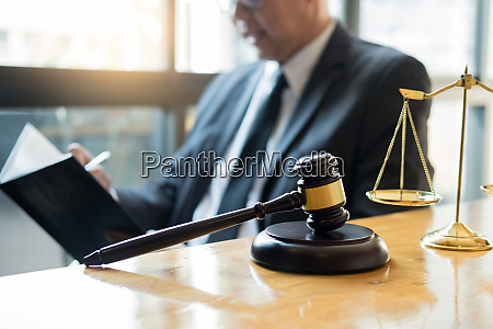 male lawyer working with contract papers