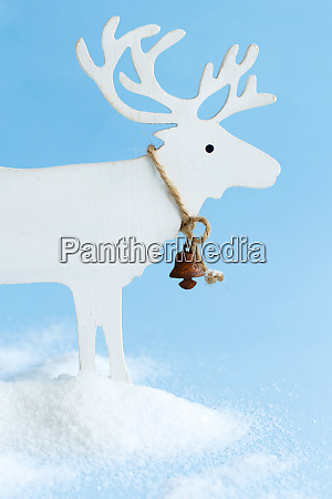 white wooden reindeer on a light