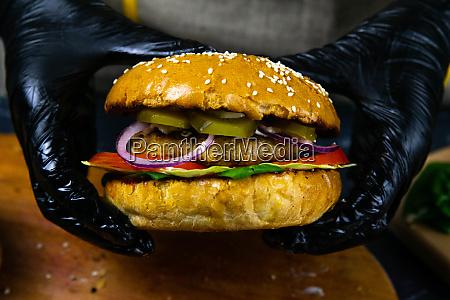 homemade burger ingredients cut bun with