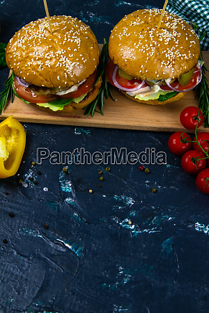two homemade beef burgers with mushrooms