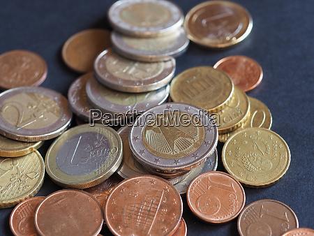 euro coins european union over black