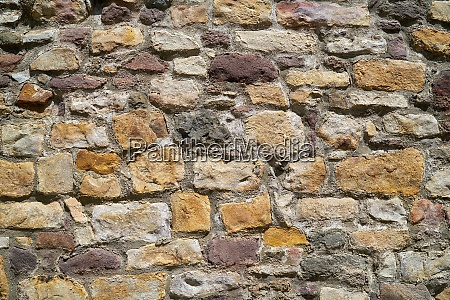 historical old wall of natural stone