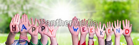 children hands building word happy weekend