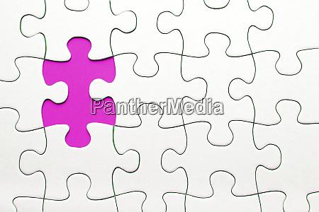 pink puzzle piece missing business concept