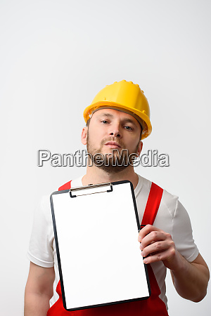 worker holding blank clipboard on white