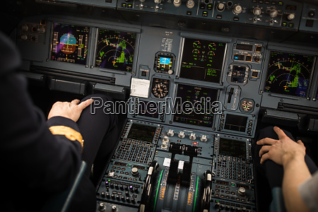 pilots hand accelerating on the throttle