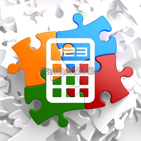 calculator icon on multicolor puzzle