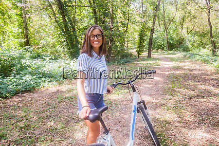 beautiful smiling girl with bicycle