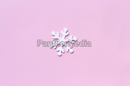 white wooden snowflake on a light