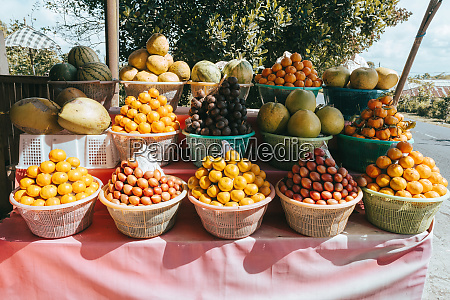tropical fruits in baskets on fruit