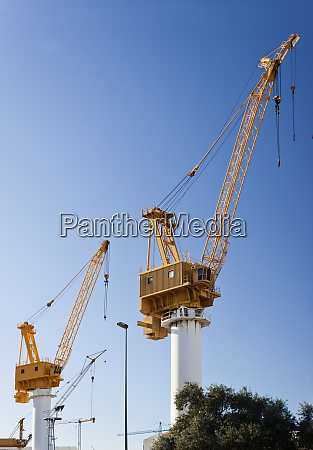 yellow cranes in the shipyard for