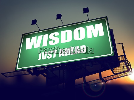 wisdom just ahead on green billboard