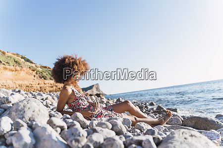 young woman wearing summer dress and