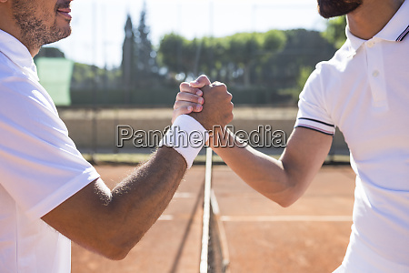 side view of two tennis players