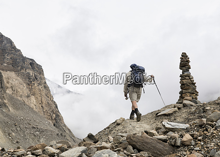 hiker at chonbarden glacier dhaulagiri circuit
