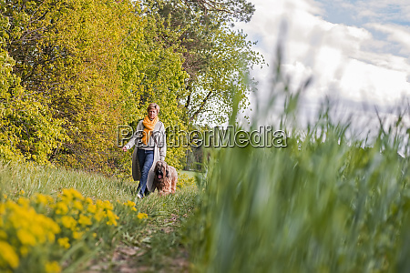 woman going walkies with dog at