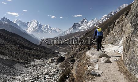 woman trekking in the himalayas nepal