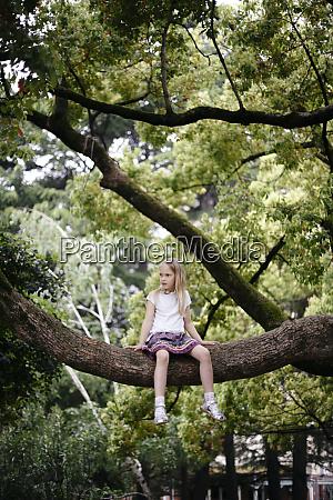 little girl sitting in a big