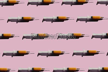 3d illustration of syringes pink background