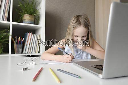 laughing girl sitting at table at