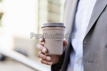 close up of businessman holding reusable