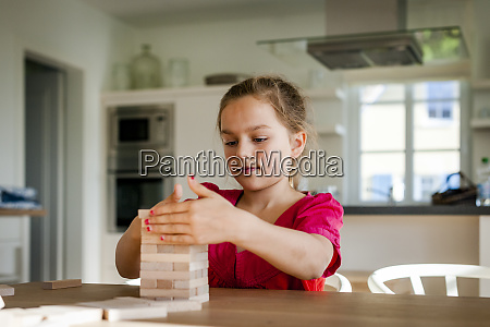 portrait of girl playing on table