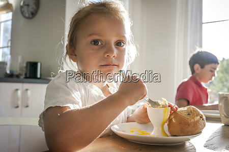 portrait of girl eating a boiled