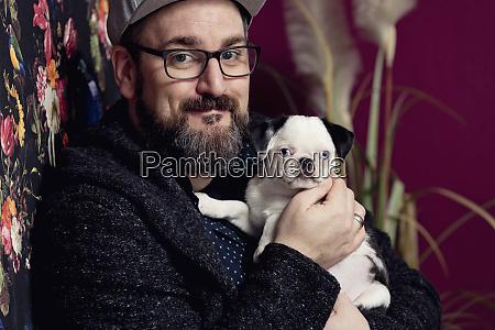 man holding his pug