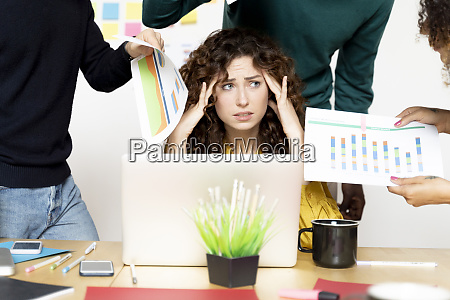 stressed woman siting at desk in