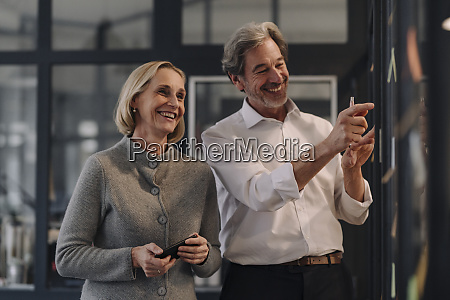 happy businessman and businesswoman working on