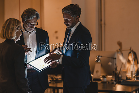 business people with shining tablet talking