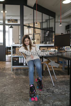 girl with roller skates sitting at